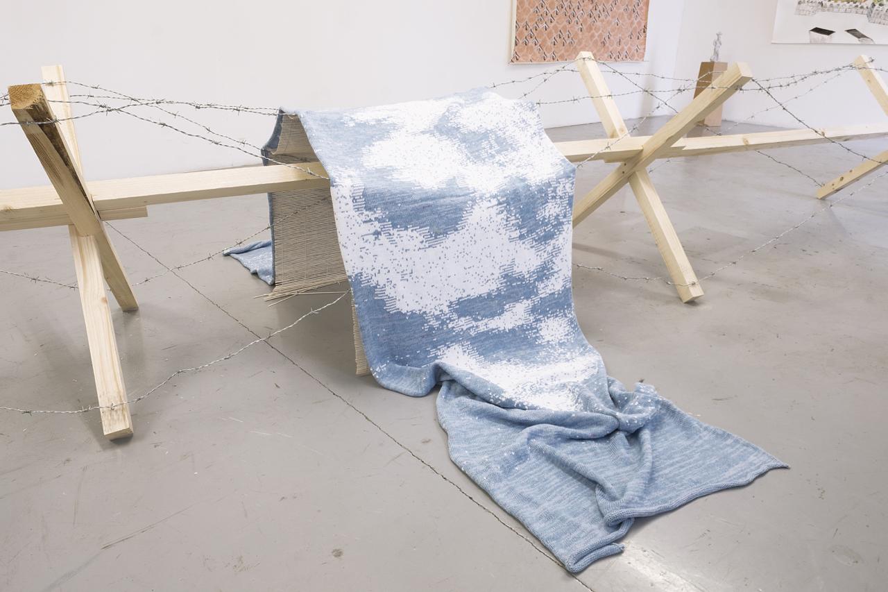 Serge Ecker, Borderhopping II, digital machine knitting, wood, barbed wire, 600x100x100cm